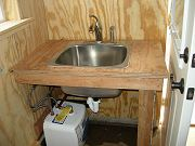 Water Heater Being Installed Under Downstairs Sink, May 11, 2010