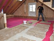 Rolling Waterproof Membrane on Upstairs Floor, June 14, 2010